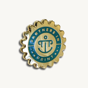 Partners in Print enamel pin