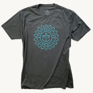 Partners in Print t-shirt (charcoal gray crew neck with blue PiP logo)